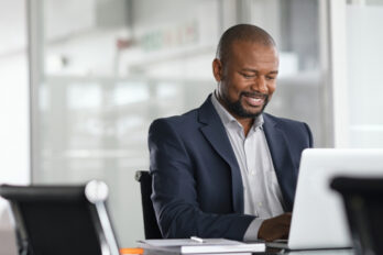 Positive,Mature,Businessman,Working,On,Laptop,In,Modern,Office.,Successful