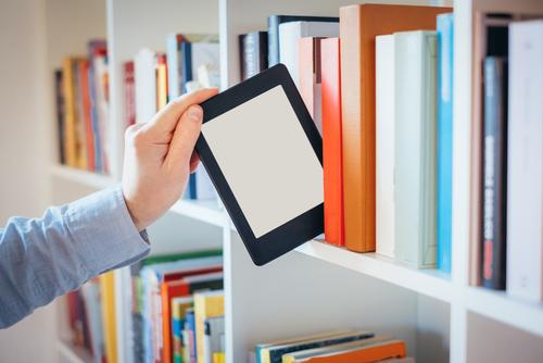 E-book,Reader,And,Colorful,Bookshelf
